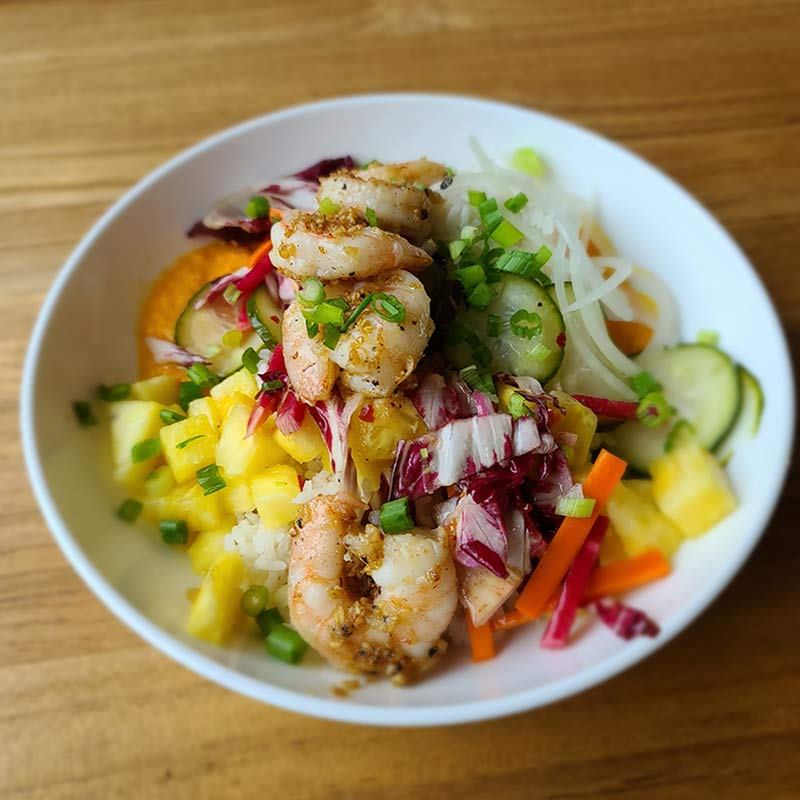White bowl filled with Garlic Butter Shrimp Rice dish