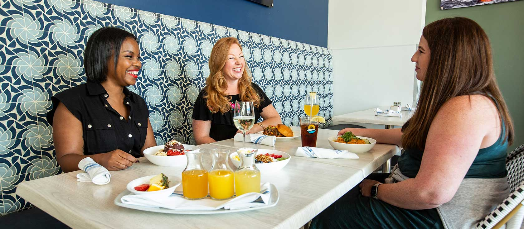 Three young women brunching together